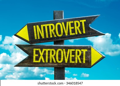 Introvert - Extrovert signpost with sky background