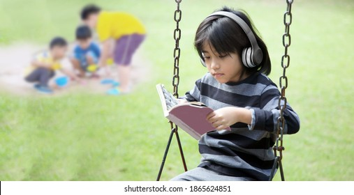 introvert mindset of asian kids happy with music in earphone and stay alone in park