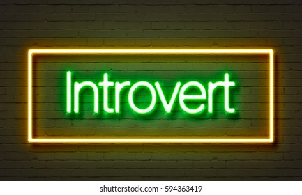 Introvert neon sign on brick wall background