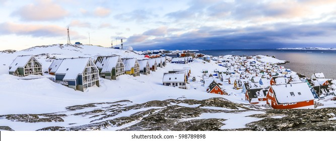 Inuit houses covered in snow. Nuuk city spring panorama, Greenland