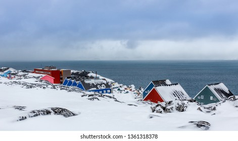 Inuit village houses covered in snow at the fjord of Nuuk city, Greenland