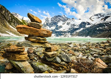 Inukshuk on the shore on Icy Lake, Lake of the Hanging Glacier, Canada