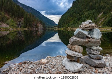 An inukshuk overlooks beautiful Griffin Lake in eastern British Columbia