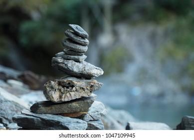 Inukshuk rock pile cairn trail marker pile in Mount Aspiring National Park, New Zealand.