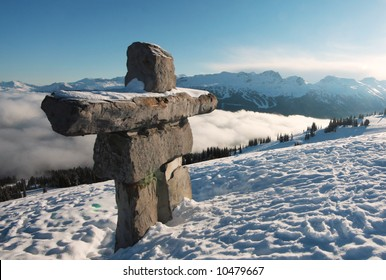 An inukshuk stands sentry over Whistler and Blackcomb mountain, British Columbia,  Canada.