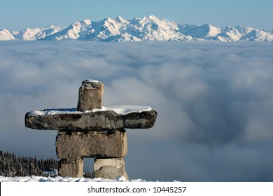 An inuksuk stands guard over Whistler Blackcomb, British Columbia, Canada.