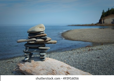 Inushuk standing on a rock in gaspesie, Quebec. An inuksuk is a human-made stone landmark.