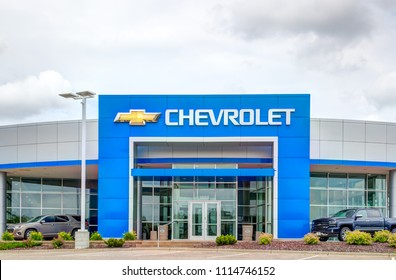 INVER GROVE HEIGHTS, MN/USA - JUNE 17, 2018: Chevrolet automobile dealership exterior and trademark logo. Chevrolet is an American automotive brand.