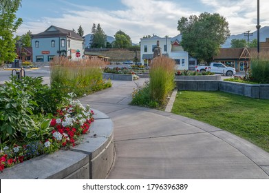Invermere, British Columbia, Canada – August 13, 2020:  Morning view of the town's main street (Seventh Avenue) with shops and landscaping