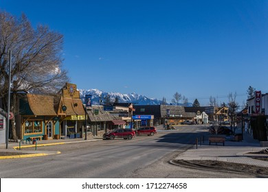 INVERMERE, CANADA - MARCH 18, 2020: main street in small town with bank and cars british columbia.