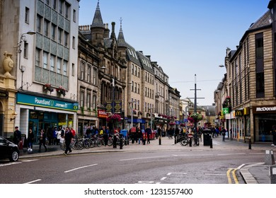 Inverness, Scotland - August 13, 2018:  Busy street filled with pedestrians in the city of Inverness, Scotland.