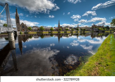 INVERNESS, SCOTLAND - JUNE 14, 2015: River Ness and Inverness city on a bright, Spring day.