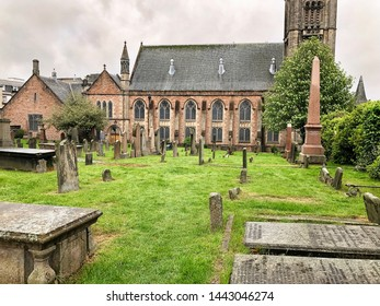 Inverness, Scotland - May 18, 2019:  Old High Church and graveyard on Bank Street in Inverness, Scotland.
