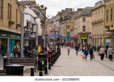 INVERNESS, Scotland, UK - July 5: Pedestrians in Eastgate in central Inverness, Scotland, UK on July 5, 2017