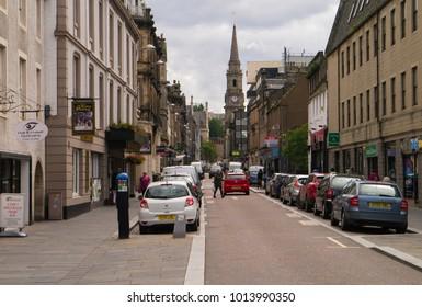 INVERNESS, Scotland, UK - July 5, 2017: Pedestrians in Church Street in central Inverness, Scotland, UK