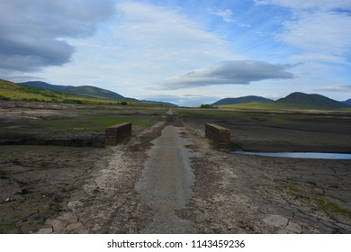 Inverness, Scotland United Kingdom – JULY 27, 2018: Due to low rainfall over an extended period the old road from Dingwall to Ullapool which is normally under Loch Glascarnoch has now re-appeared.