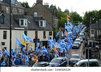 Inverness, Scotland United Kingdom – JULY 28, 2018: A line of pro-independence supporters walk up Castle Street as part of the All Under One Banner March for Independence in Inverness by S Fraser