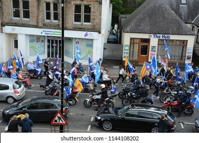 Inverness, Scotland United Kingdom – JULY 28, 2018: A line of pro-independence 'Yes Bikers' greet  the wheelchairs leading the march on Castle Street  as part of the All Under One Banner March for Ind