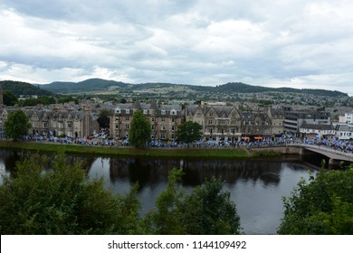 Inverness, Scotland United Kingdom – JULY 28, 2018: A line of pro-independence supporters walk along Ness Walk beside the River Ness as part of the All Under One Banner March for Independence in Inver