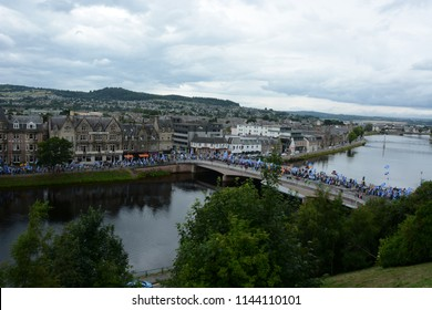 Inverness, Scotland United Kingdom – JULY 28, 2018: A line of pro-independence supporters on Ness Walk and the Ness Bridge as part of the All Under One Banner March for Independence in Inverness by S