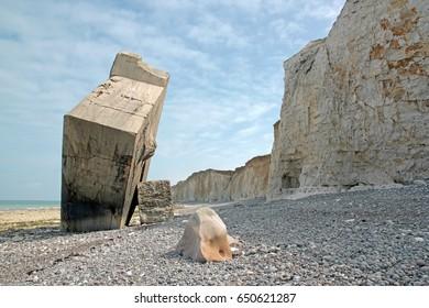 Inverted Blockhouse of Sainte-Marguerite-sur-mer. Pebbles, rocks, and cliffs. Bay of Somme France. The last war