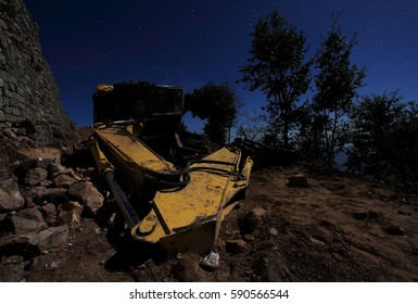 Inverted excavator on the road. Moonlit Night in the Himalayas. Nepal