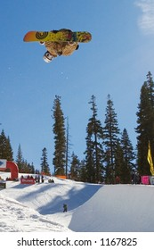 Inverted pro snowboarder in superpipe competition