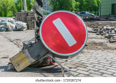 Inverted road sign chained to a pole during road repair. Dead End Warning Road Sign