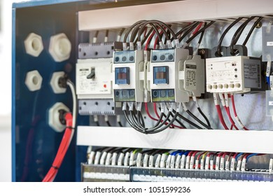 Inverter controller drive or Automatic electrical connector located inside of an industrial switch control panel board.