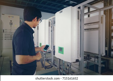 Inverter solar panel with technicians checking