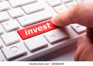 invest or investment key or button in red showing business success