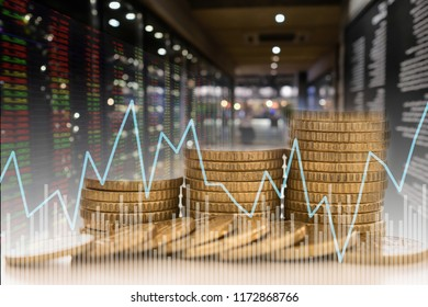 Invest money and finance concept. coins stack with value index stock exchange with stock market graph and chart.