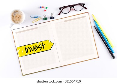 Invest text on notebook with copy space