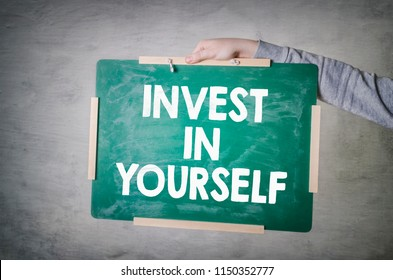 Invest In Yourself. Education concept with blackboard in hand. Improve your Skills.