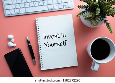 Invest in yourself. Note book with text. Self improvement concept