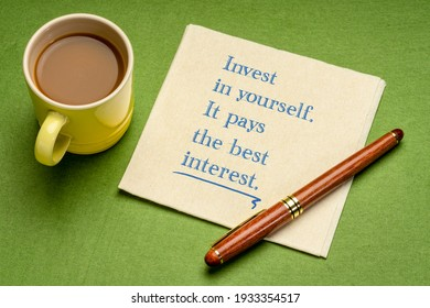 Invest in yourself. It pays the interest. Motivational advice or reminder - handwriting on a napkin with cup of coffee. Lifestyle and personal development concept.