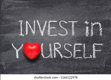 invest in yourself phrase handwritten on chalkboard with red heart symbol instead of O