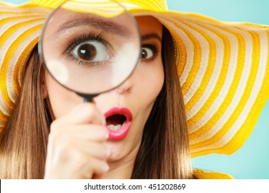Investigation exploration education concept. Closeup woman face surprised expression, girl holding on eye magnifying glass loupe