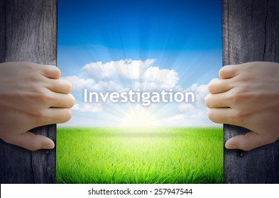 Investigation. Hand opening an old wooden door and found Investigation word floating over green field and bright blue Sky Sunrise.