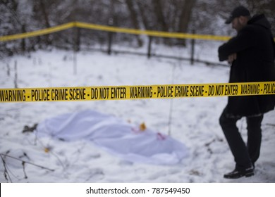Investigator approaching  the dead body.