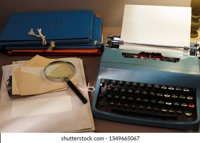 Investigator desk with confidential documents. Secret documents, vintage typewriter, magnifying glass on a table.