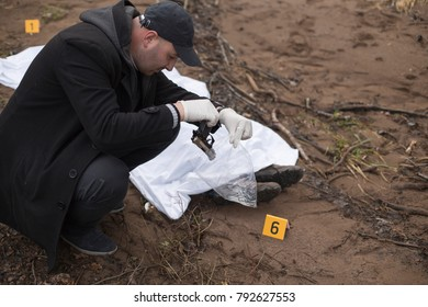 Investigator finds the gun next to the homicide victim.