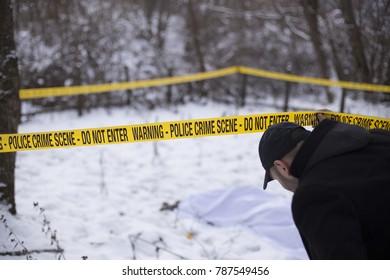 Investigator passing under crime scene track.