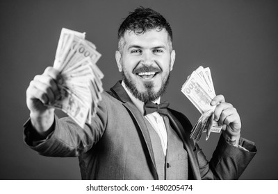 Investing to become rich. Business startup loan. Bearded man holding cash money. Making money with his own business. Currency broker with bundle of money. Rich businessman with us dollars banknotes.