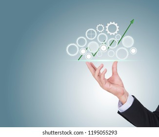Investing in growth financial business concept as hands holding a finance pie chart and arrow made of machine gears and cog wheels as a symbol supporting technology with growth potential.
