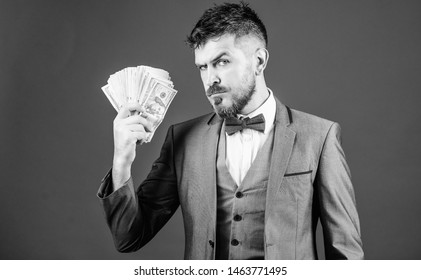 Investing money. Rich businessman with us dollars banknotes. Currency broker with bundle of money. Making money with his own business. Business startup loan. Bearded man holding cash money.