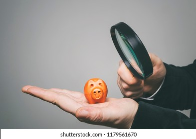 Investing, personal finance and financial planning. The inspector uses a magnifying glass for inspecting financial reliability and credibility.
