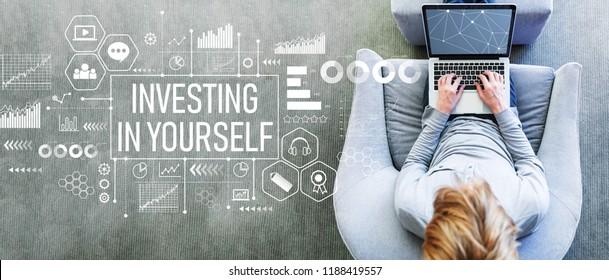 Investing in yourself with man using a laptop in a modern gray chair