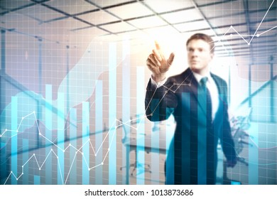 Investment and banking concept. Businessman pointing at forex chart on abstract city office background. Double exposure
