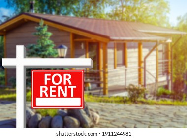 Investment or business in  field of rental property. For rent sign as symbol of business in rental property. Rental business. Blurred country house in background. Investment in renting country house